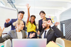 Founders celebrating with enthusiasm. Founders of start-up celebrating with enthusiasm and cheering at the office stock photo