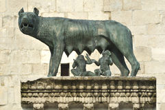 Founding of Rome. Ancient roman bronze of the she-wolf suckling romulus and remus the traditional founders of the city and empire of rome at the UNESCO listed Royalty Free Stock Images