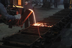 Foundry or casting. A view of foundry or casting  process  in a automobile manufacturing unit Stock Image