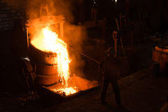 Foundry Worker Removing Slack Stock Photo