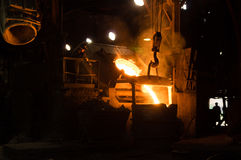 Foundry Worker Watching Hot Liquid Metal Flow Stock Images