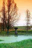 Fountain. With stone column in the fall in the portrait format Royalty Free Stock Photography
