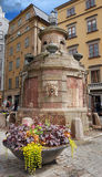 Fountain. Medieval fountain-well on Stortorgsbrunnen square in Stockholm, Sweden Stock Photo