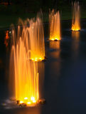 Fountain. In the garden at night Stock Images