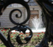 Fountain. Iron fence with fountain in background Stock Photos
