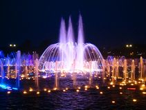 Fountain. Night fountain with multi-coloured illumination Royalty Free Stock Photography