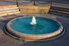 Fountain. The urban fountain with blue water Royalty Free Stock Image