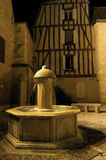 Fountain. Small village at night in French Royalty Free Stock Photos