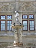 Fountain. Pigeon sitting on the sculpture of a fountain at the vienna state opera house stock image