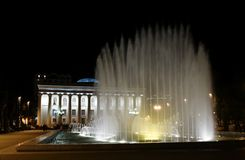 Fountain above museum of carpets at night Royalty Free Stock Images
