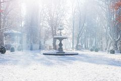 Fountain and advent stalls of Zrinjevac Park in Zagreb in winter with snow and sunshine, Croatia, Europe Royalty Free Stock Image