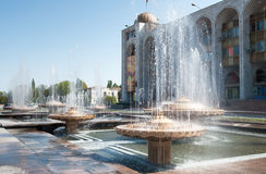 Fountain on Ala-Too Square. BISHKEK, KYRGYZSTAN - MAY 02, 2014:  Fountain on Ala-Too Square. Bishkek formerly  Frunze, is the capital and the largest city of the Royalty Free Stock Photos