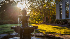 Fountain and Alabama Sunset. Picture of peaceful water fountain against a golden Autumn Alabama sunset in Montgomery, Alabama royalty free stock image