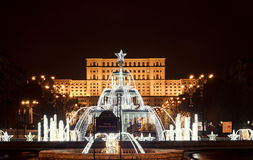 Fountain `Alexandru Ioan Cuza` lighted and ornaments in front of The House of People. Downtown of Bucharest, Romania night time royalty free stock photos