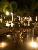 Fountain And Trees In Resort After Dark Royalty Free Stock Photos