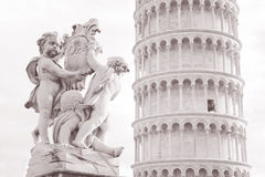 Fountain with Angels - Fontana dei Putti and Tower in Piazza dei Stock Image