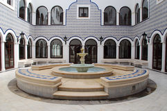 Fountain in arabic patio. Panoramic view of marble fountain in arabic style patio Royalty Free Stock Photography
