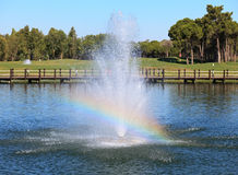 Fountain in the artificial pond. Royalty Free Stock Photography
