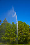 Fountain in the artificial pond. High shutter speed to freeze water drops (1/4000 s Royalty Free Stock Image