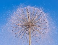 Fountain as dandelion with a blue sky Royalty Free Stock Photos
