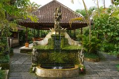 Fountain in an Asian garden stock photography