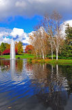 Fountain in the background amungst fall colors. Stock Image