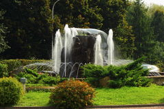 Fountain. On a background of green water flowing from the fountain Royalty Free Stock Image