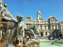 The fountain Bartholdi and the Lyon city hall, Lyon, France. The city hall of Lyon in the Lyon old town with the horse sculpture in the fountain Stock Photo