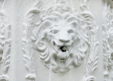 Fountain in bas-relief of lion Stock Photos