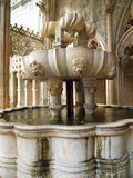 Fountain in Batalha Monastery. Orante fountain located in the courtyard of Batalha Monastery Royalty Free Stock Image