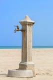 Fountain beach. A lonely fountain on the italian beach Stock Photos