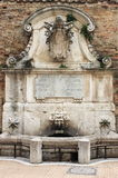 Fountain of Benedict XIII in Urbino Stock Images