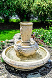 Fountain Birdbath with Lion heads. A Fountain Birdbath with Lion heads and a large pot at the top Royalty Free Stock Photography