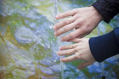 Wedding photography. Beautiful couple, hands and wedding rings. royalty free stock image