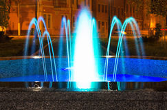 Fountain with blue light in the night city Royalty Free Stock Image