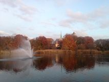 A Fountain in Branch Brook Lake in front of Cathedral Basilica of the Sacred Heart in the Fall. Stock Photo