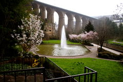 Fountain by the bridge. Spring in Luxembourg Stock Photography