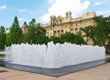 Fountain in Budapest. Modern fountain with historic building in Budapest, Hungary royalty free stock image