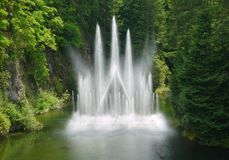 Fountain at Butchart Gardens. Butchart Gardens on Vancouver Island in Victoria, British Columbia was created from an old quarry pit royalty free stock images