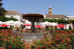 Fountain and cafes, Estepona. Stock Images