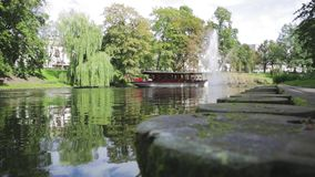 Fountain on the canal in the center of Riga, Latvia stock footage