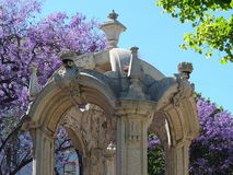 Fountain of Carmo Detail. In Carmo Square in historical Lisbon, stands a drinking water fountain, carved with intricate details of pillars, arches, shield, and Stock Photos