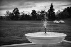 Fountain and cars Royalty Free Stock Photography
