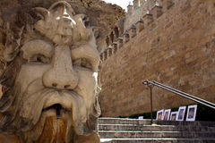 Fountain with carved face Royalty Free Stock Images