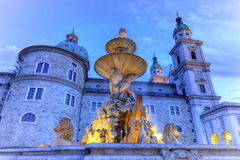Fountain and cathedral at the Residenzplatz in Salzburg, Austria Stock Image