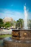 Fountain in center of Corfu city (Kerkyra) with castle in backgr Stock Image