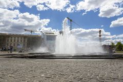 Fountain in the center of the Lustgarten park on the Museum Island. Berlin, Germany - July 01, 2018: Fountain in the center of the Lustgarten park on the Museum Stock Image