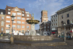 The fountain of Charity (Caritas Well) on old square in central Copenhagen. Denmark Stock Photos