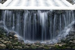 Fountain `Chess Mountain`, mysterious grotto with water curtain royalty free stock images