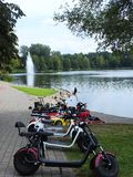 Lake, tress, fountain and children scooters, Lithuania royalty free stock images